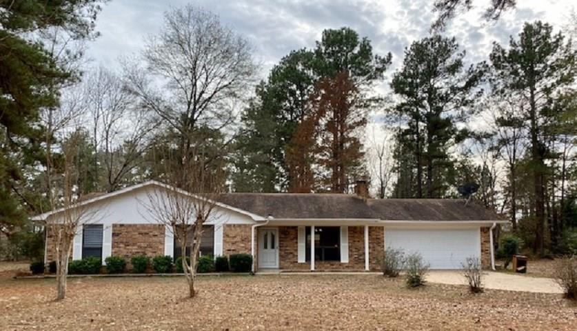 Enjoy country living in this well-maintained 3/2/2 brick home on 18+ acres mostly wooded with live creek in the Elkhart ISD.