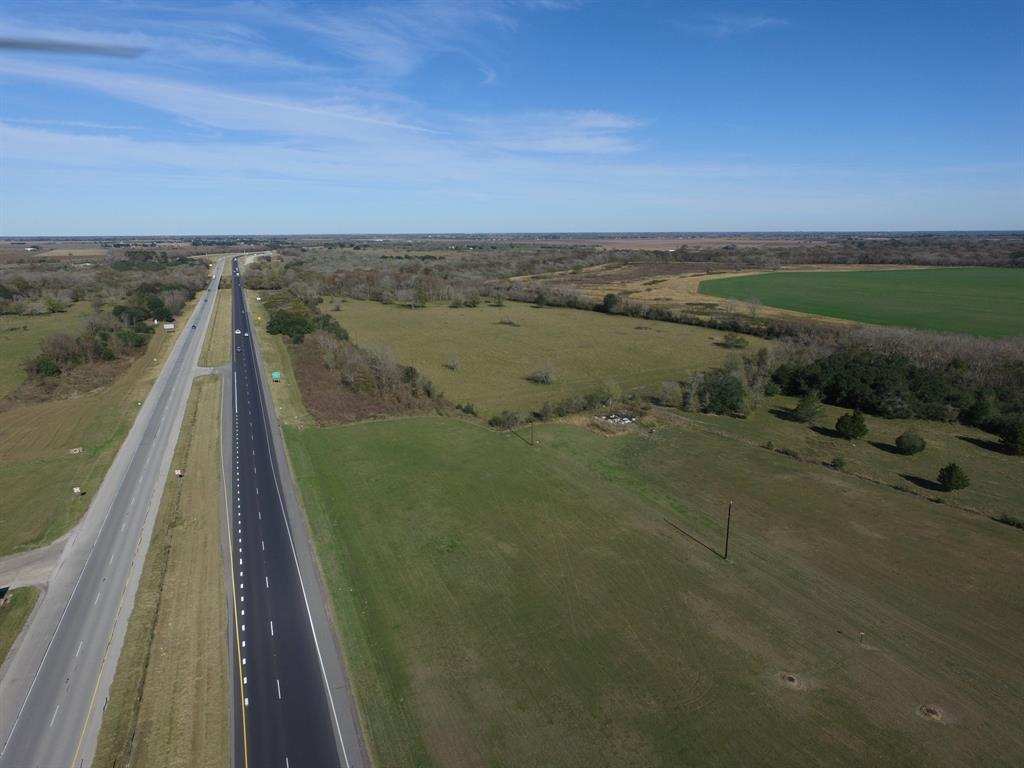 This fantastic 20.7 acre tract on Hwy 59/69 has access from FM 1161 as well! Imagine the commercial investment opportunities at this location where traffic flows thru and around the 1161 overpass! This land has never flooded! 