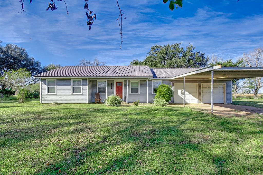 Adorable & Affordable!!! Check out this home located on 2.86+/- acres in Needville; Exterior includes:  TREES, aluminum roof, fenced/cross fenced, shed row barn, cistern, animal pens, carport, and attached garage.  Interior features include:  wood floors in most areas of the house, gas stove, large kitchen and huge walk in pantry, jacuzzi tub in bathroom and 2 generous sized bedrooms.  Located just minutes from Needville Schools and major freeways for easy access to Richmond/Rosenberg, Sugar land/Houston, as well as Wharton and Wharton College.