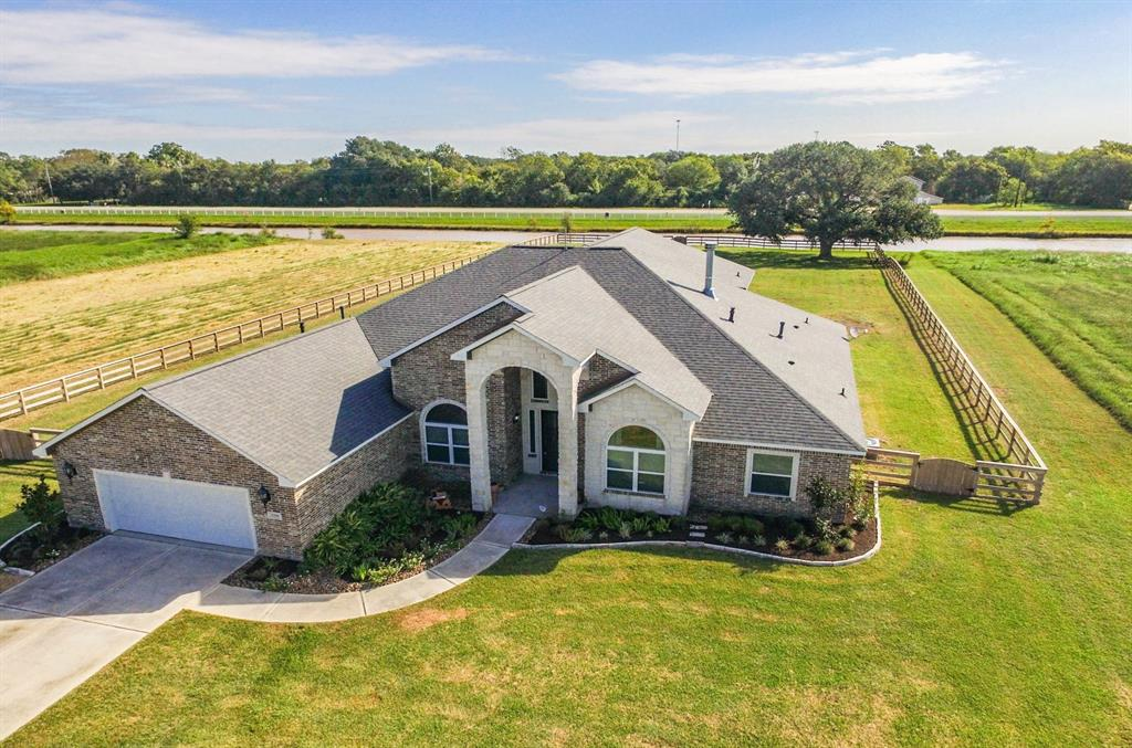 This GORGEOUS fully custom brick/stone, well-maintained home sits on 1 acre w/views of canal. Completely fenced with a gated entrance. Custom cabinetry throughout w/tons of storage. High ceilings w/double-crown molding & wood-look tile throughout the home. Gourmet kitchen features high-end appliances,  huge island & breakfast bar open to the living area. Living room features a stone fireplace w/wood mantle preserved from a  sugar factory & custom cabinets on each side. Spacious master w/tray ceiling, spa-like bath, and a custom closet w/secret room. Secondary bedrooms w/jack-n-jill w/urinal and ladder in each closest to the upper level.  The 4th guest room w/full bath is in separate wing. A study and fantastic utility room round out the 1st level. Up you will find a Texas-sized game-room/media room & full bath. There is also a fitness center w/water fountain & access to a covered patio. Huge covered patio down w/outdoor kitchen. This home has it all! 1 acre lot next to home available!!