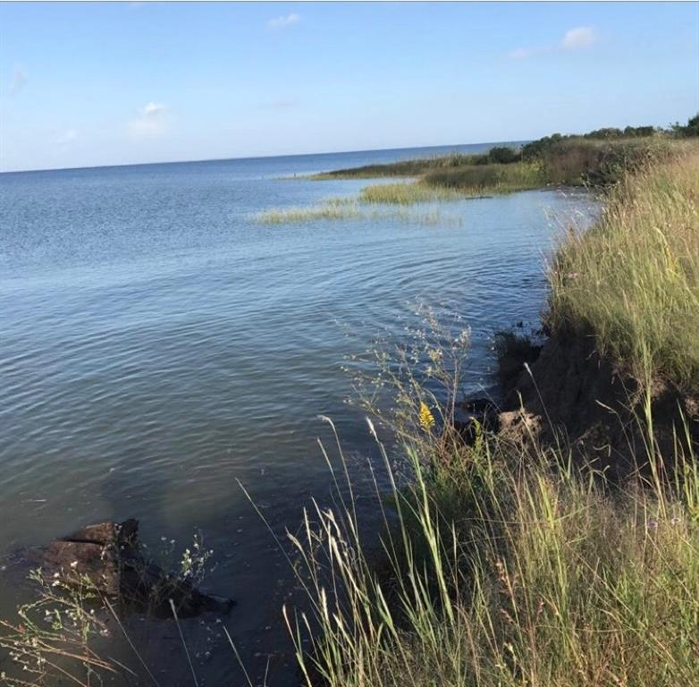 WATER FRONTAGE WITH GREAT OPPORTUNITIES. FISHING, BOATING, AND MUCH MORE. OVER 16 ACRES. TRINITY /GALVESTON BAY.
