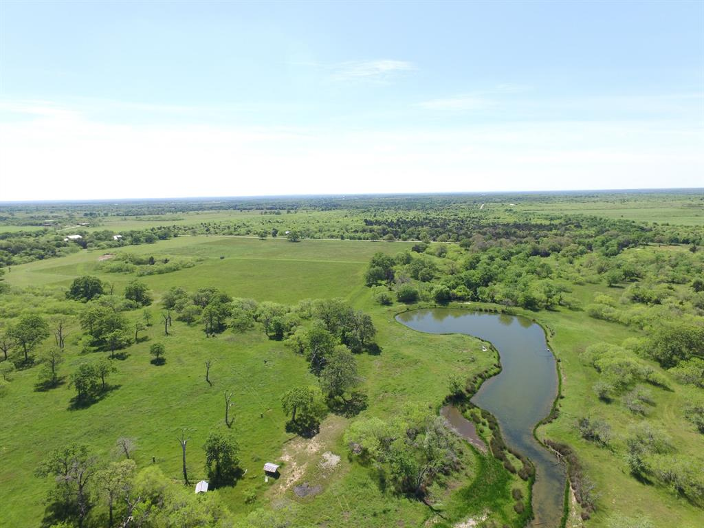 high fenced property previously used as an exotic game ranch in the Cistern area with 2 ponds, seasonal creek, pecan, post oaks, mesquites. Create your family ranch, hunting ranch or exotic game ranch with this blank slate. There is an old water well that was capped and Fayette Water Supply Corp water available at the road. 18 acres are cleared and are ready to be planted as food plots or a coastal hay patch. The big pond has a feeder and is stocked with catfish, bass and perch. This ranch fronts two roads with all roads approaching the ranch being paved except Robbins Cemetery. Soil is mostly Sandy Loam with some Clay Loam. Some flood plain around the Live Oak Creek that meanders through the property. Cattle pens and catch pen on the property.