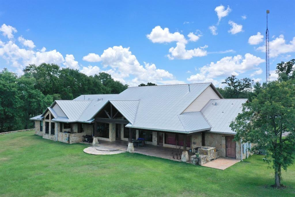 BCR Ranch is a remarkable 90 acre cattle/equestrian property coined by its 6000± sq. ft. gorgeous custom Austin stone home and 2000± sq. ft. guest quarters & garage space. Enter this breathtaking home through the automatic gated pipe & stone entry on the paved FM 974 in Bryan, TX. Exterior elements like the 1900± ft. of frontage on FM 974, paved circle driveway, elegant custom finishing & impressive layout make this striking property an excellent investment. Other ranch improvements include a functional 60X50 steel show cattle barn/ horse barn with pipe working pens & a newly constructed 10600± sq. ft. barn, covered arena area or working pen/equipment storage space. Each pasture is fully designed for easy rotation and boasts water troughs & stock ponds throughout. Among the open rolling terrain, improved pastures, scattered trees, cross-fencing, 5± ac lake, creek & scenery – BCR Ranch poses all the amenities to combine luxurious country living with a productive livestock operation!