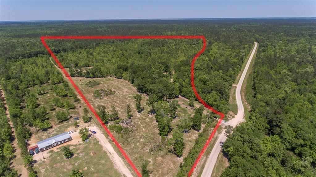 Ever thought of owning your own huge chunk of dream property?? Your opportunity is now. 50 Beautiful acres to develop as you wish. Waterfront- the entire property runs along Turtle Bayou plus a bonus pond.