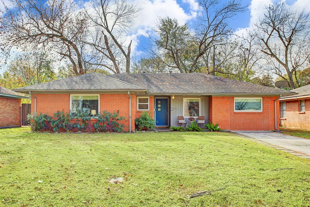 Welcome to 5025 Nina Lee Lane! This inviting and colorful exterior features new windows, repainted Mid-Century style front door, decorative concrete pavers along the driveway and fresh landscaping on a beautiful 6,504 sq ft lot.