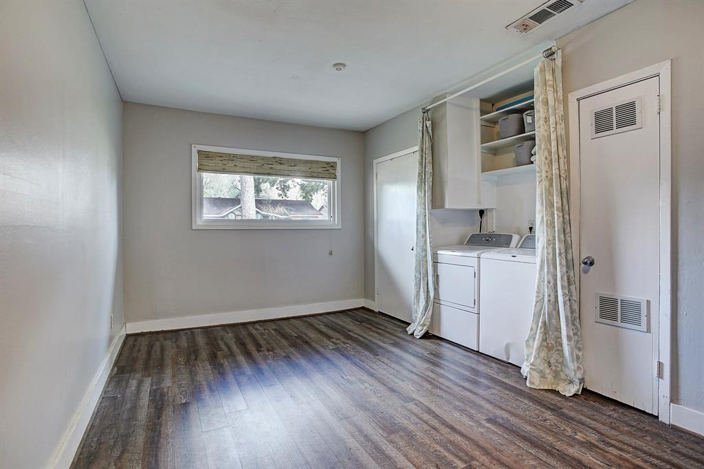 Converted garage room is the perfect flex space for storage or use as an additional bedroom, office, utility/storage room.  Features storage closet, area for washer/dryer with shelving and water heater (2017). Picture window lets light flow in. Recent flooring and neutral paint.