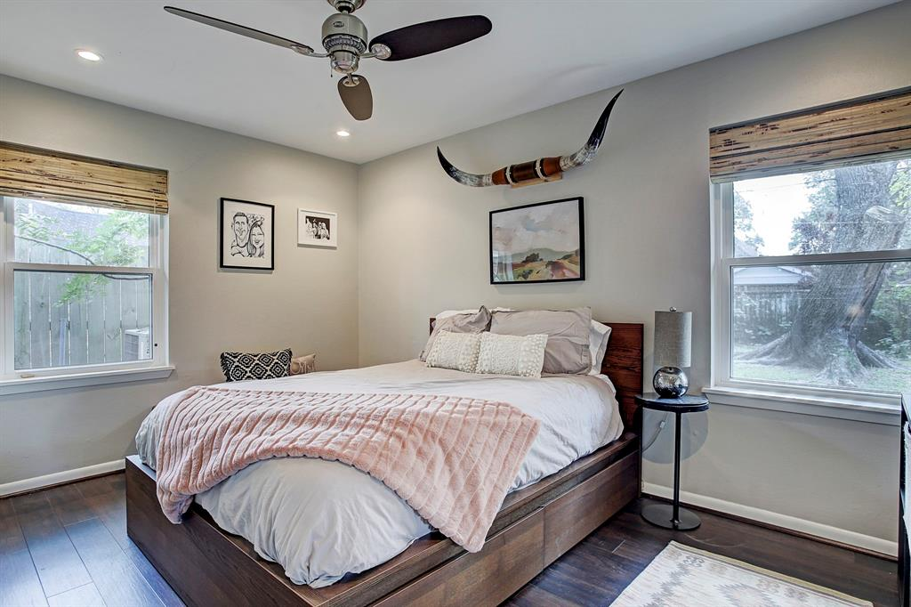 Third bedroom features new flooring, neutral paint, new windows with new shades, recessed lighting and a Hunter ceiling fan.