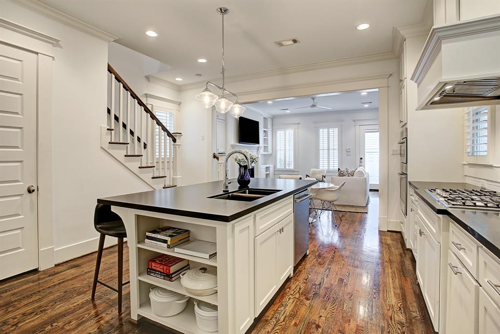 The kitchen is so thoughtfully laid out and finished, with Bosch appliances. The door to the left leads to fabulous under-stair storage.