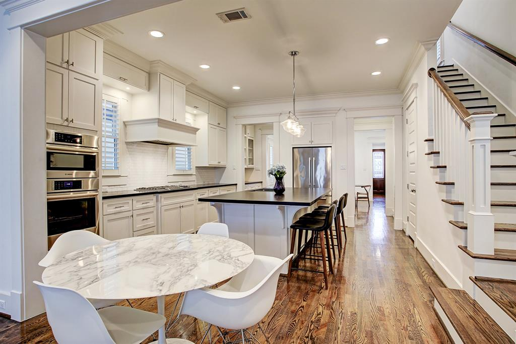 Between the kitchen and family room there is additional space for a more casual dining set up.