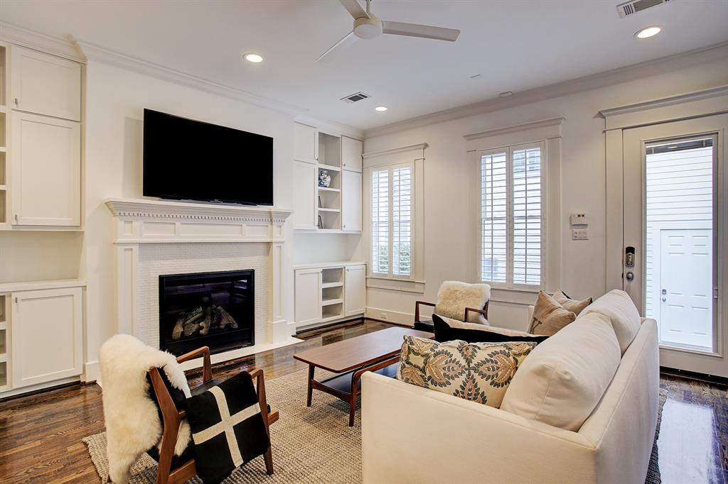 This space is complete with a fireplace and floor to ceiling built-ins.