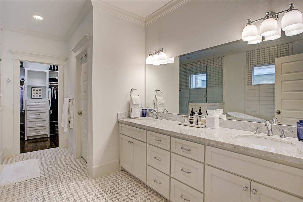 The master bath is a crisp palette with classic, timeless finishes.