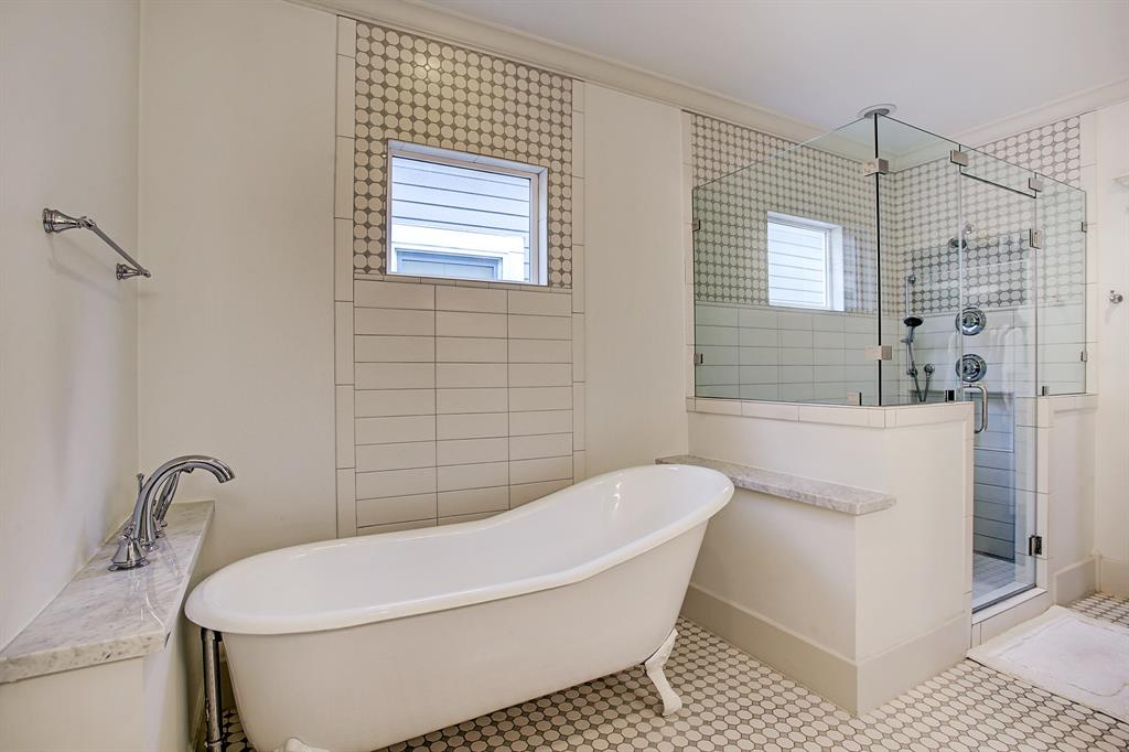 The free standing soaking tub adds a Victorian feel to this spa-like retreat.