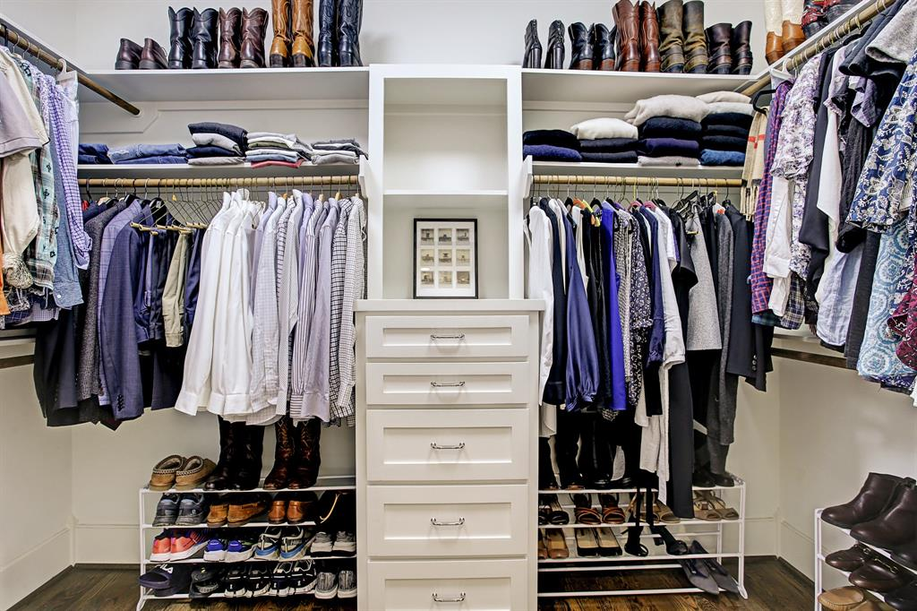 The master walk-in closet does not disappoint, it is big and thoughtfully outfitted including dresser space.