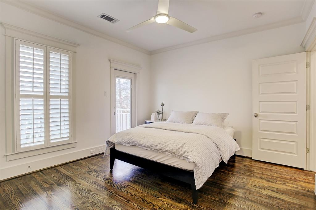The second bedroom sits at the front of the second floor with access to the balcony looking over 24th St. and includes a walk-in closet with a window.