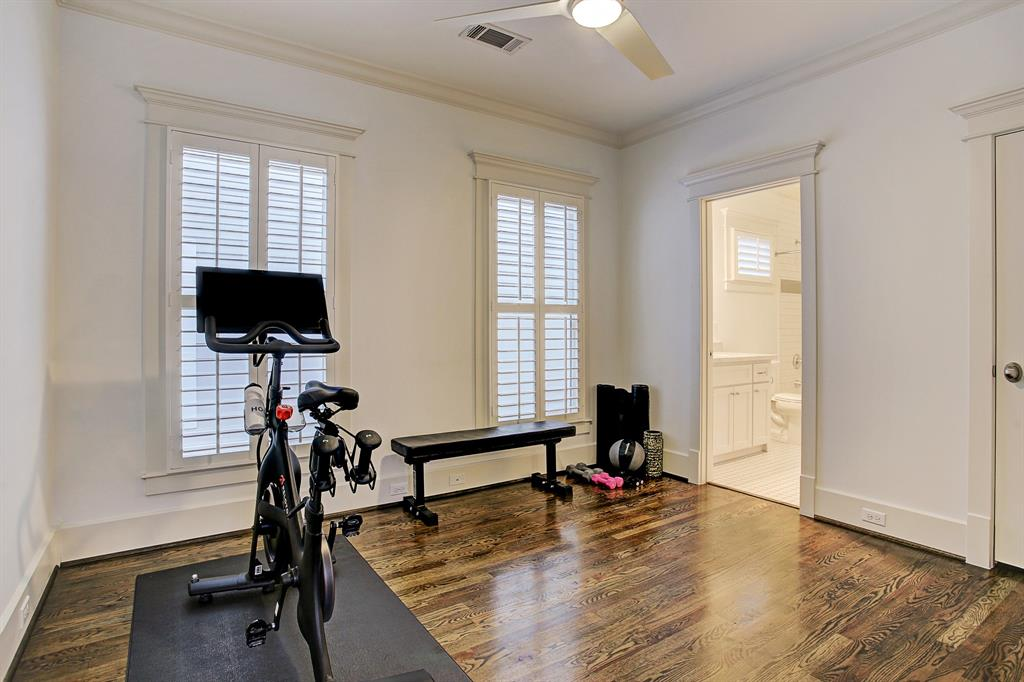 The third bedroom is currently being used as workout space, though certainly comfortably would accommodate a full bedroom furniture set up.