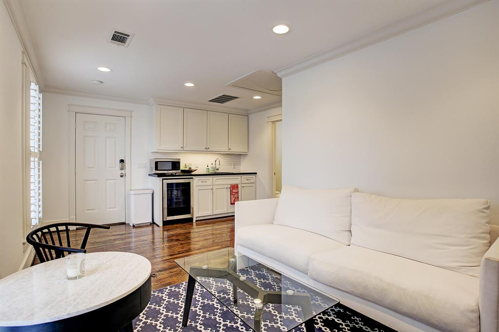 The one bedroom garage apartment is finished as beautifully as the main house, with crown molding, hardwood floors and keyless entry.