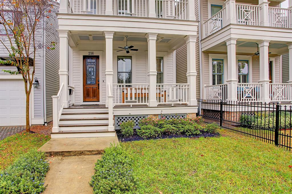 The wide front porch and second floor balcony both have plenty of room for comfy furniture.