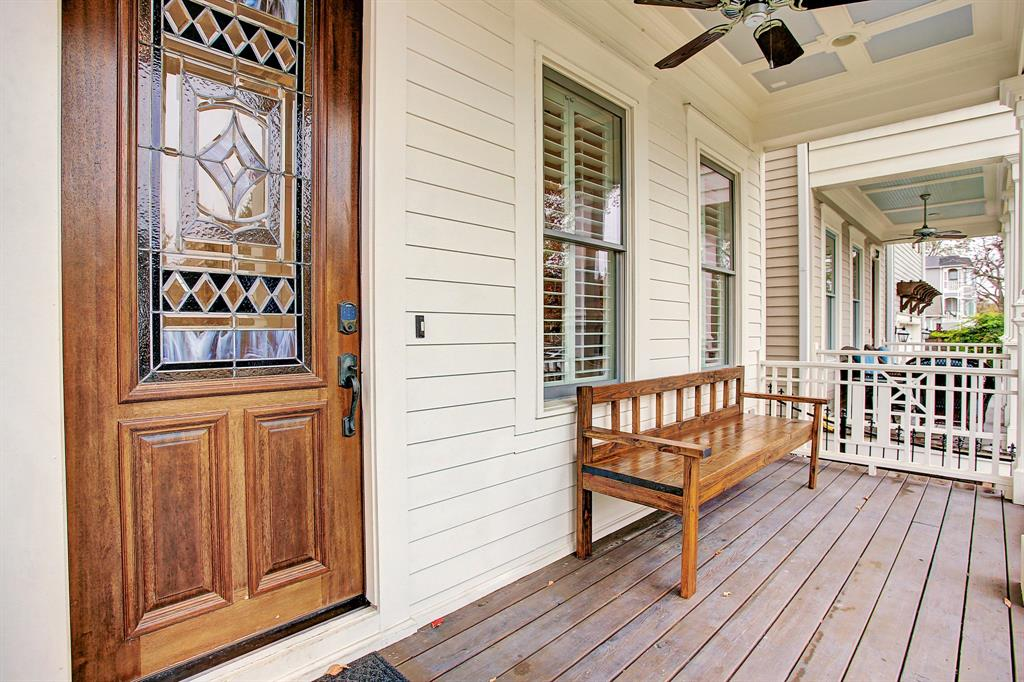 The art glass front door into the home's foyer offers light and privacy, as well as ease with a keyless entry pad.