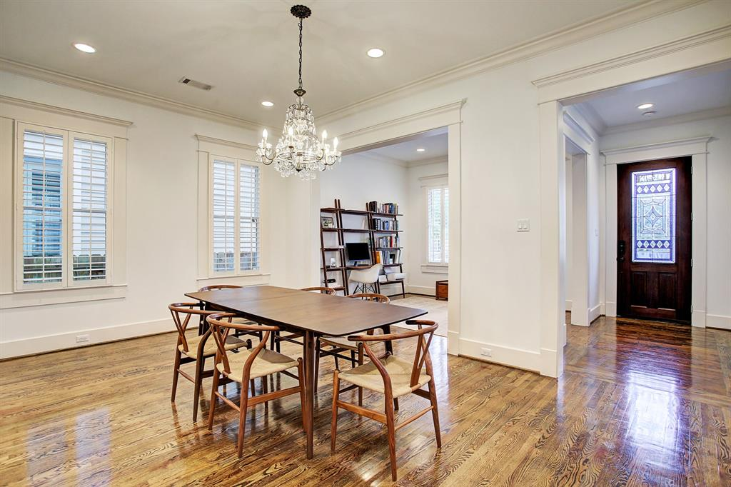 The dining room here is quite big and could readily accommodate a larger table, sideboard, etc.