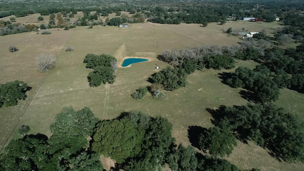 Here is the property you have been waiting for!  Beautiful!  Scattered oaks and other native trees, recently netwire fenced, 2 ponds, recently installed/dug water well, electricity (2 meters), 1200 sf old tin barn.  This is a great place to build a home or just have a few cows and do a little hunting.  Don't miss out on this one!