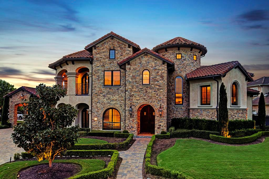 TUSCAN-INSPIRED MASTERPIECE located within the gated ''Estates'' of Royal Oaks Country Club. Perfectly designed over a sprawling 23,900+ square foot homesite (-per HCAD), this phenomenal home is a pinnacle of quality & beauty! Soaring solid wood tresses, hand-scraped white oak floors, stained concrete counters, Sub-Zero/Wolf appliance package throughout, breathtaking floating staircase, marvelous stonework & impeccable attention to detail. Capture views of 14th green from the upper front balcony. You will marvel over the custom designed outdoor living area that is a wonderful extension to this magnificent sanctuary. Complete with summer kitchen, fireplace, outdoor speakers & beautiful stonework, you will enjoy the covered loggia year-round. The cascading heated saltwater pool & spa overlooks the massive backyard and serene willow tree. Stimulating design & craftsmanship cover every square inch of this impressive & heart-felt home!