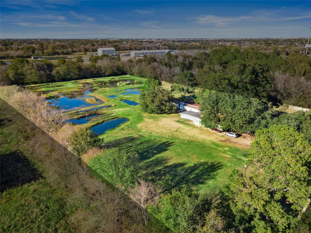 Located in the highly coveted Katy ISD with convenient access to both I-10 and Grand Parkway, this wonderful 6-acre +/- property features a 2769 Sq.Ft. +/- Home, Kennel Building with 12 indoor/outdoor runs, 7 Technical Training Ponds for Retrievers, and a covered parking spot for your RV!  Numerous mature trees lend to the park-like setting, and the ponds attract abundant wildlife. Wild ducks, hawks, osprey, and great horned owls have been observed nesting on the property.  Bald eagle sightings are not uncommon.  The property has 2 Water Wells and 2 Septic Systems. Grooming area located inside the kennel building that has hot/cold water, and washer/dryer hookups. The Home has Tile floors throughout and has 4 bedrooms, 3 baths, a laundry room plus an office/workroom addition of 2 rooms plus 3 large closets.  RV parking cover is 13'Wx58'Lx13' T with 30 amp service and water.  All the dirt that was removed for the ponds is still on the property and serves as the raised banks for the ponds