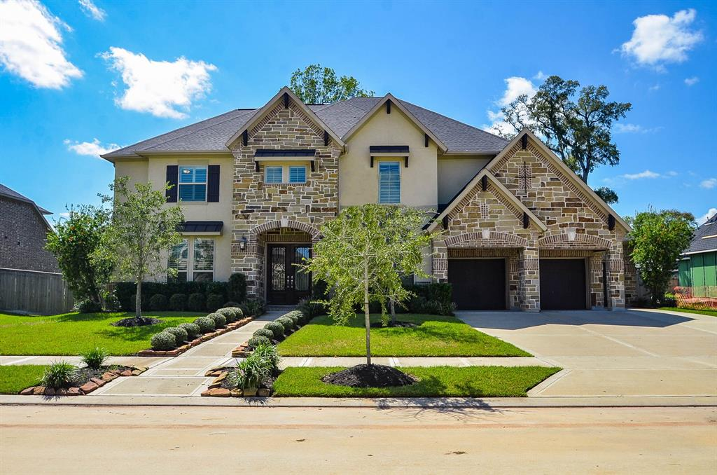 THIS CHARMING HOME IS SITUATED IN HIGHLY DESIRABLE SIENNA PLANTATION! THIS RESIDENCE BOASTS OF INCREDIBLE CURB APPEAL! ENTER AND YOU WILL FALL IN LOVE WITH THE RICH HARDWOODS THROUGHOUT!  THE INTERIOR FEATURES MANY UPDATES SUCH AS GRANITE COUNTERTOPS, PLANTATION SHUTTERS, AND ADDED BUILTINS TO LIVING ROOM, STUDY, LAUNDRY, & STORAGE ROOM! THE OPEN FLOOR PLAN IS IDEAL FOR ENTERTAINING! THE KITCHEN IS AMAZING! YOU WILL DELIGHT IN THE HUGE, OVERSIZED ISLAND THAT OVERLOOKS THE BREAKFAST ROOM & LIVING ROOM! IT FEATURES BEAUTIFUL GRANITE, STAINLESS APPLIANCES, GAS COOKTOP, & RICH WOOD CABINETRY!  THE MASTER IS SPACIOUS & HAS A LUXURIOUS MASTER BATH WITH SHOWER & SOAKING TUB! THERE IS AN ADDITIONAL BEDROOM ON THE FIRST FLOOR WITH ENSUITE BATH! THIS HOME ALSO FEATURES A GAME ROOM, MEDIA ROOM, STORAGE ROOM, & 38KW GENERATOR! THE HUGE BACK YARD HAS A COVERED PATIO WITH AN ADDED ENTERTAINMENT AREA!  YOU DON'T WANT TO MISS THIS HOME!