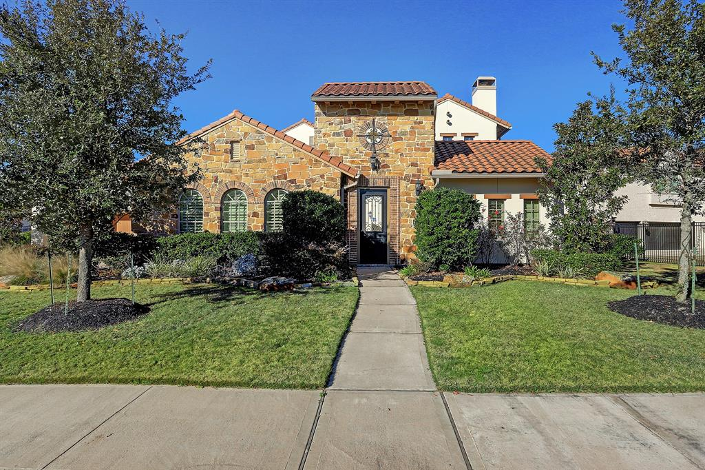 Elegant Mediterranean style home by Darling Homes on the Lake in Cross Creek Ranch with Pool Size Backyard! Enter through the 9ft Iron Door that opens into the Interior Courtyard with covered Outdoor Living Room with Gas Fireplace! Private Casita with hardwood floors and private bathroom. Through the Courtyard and into the Front Door with Architectural Details are Everywhere! Archways and Timber Ceiling Beams and Beautiful Fireplace in Front Great Room, covered in beautiful Hardwood Floors. Plantation Shutters Throughout Home, even in the 4 Car Garage! Separate Family Room, and Breakfast Room with Fireplace open into a True Chef's Kitchen with Expansive Granite Island, Kent Moore Cabinets, Elegant Backsplash and Tile Work, 6 Burner Gas Cooktop, Double Ovens, and Tons of Cabinet and Countertop Space! Two Stairways up to Three Huge bedrooms, Game Room and Oversized Media Room, Balcony overlooking the Huge Backyard and Lake! Don't Miss This Gorgeous Home!