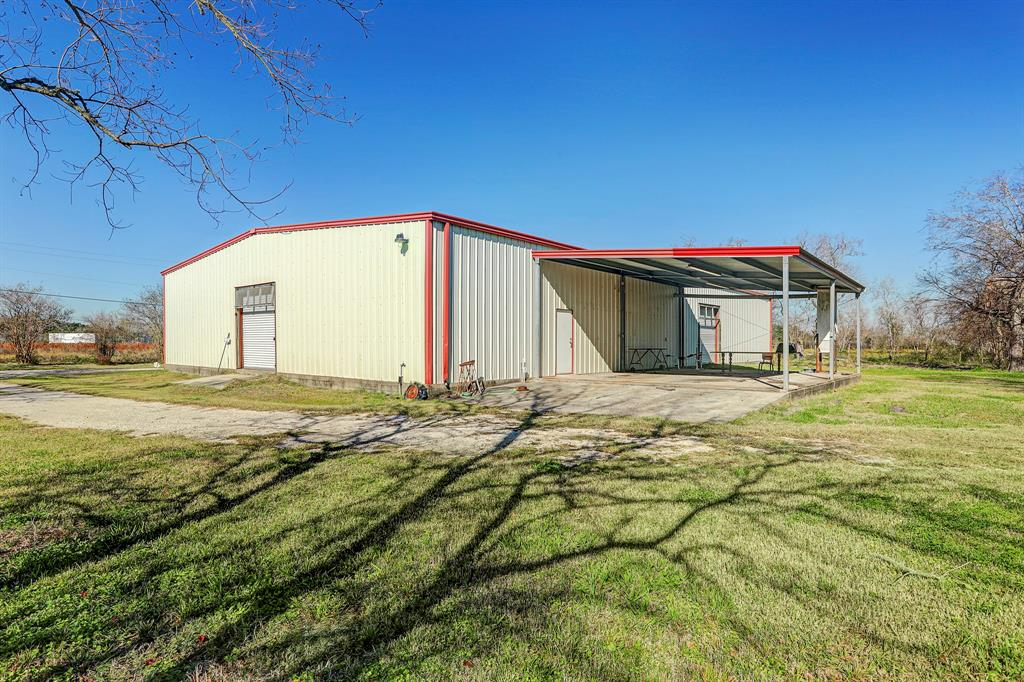 Former cabinet manufacturing facility sitting on approximately 23 acres. The main building is 60X100 with a 2 Bedroom 2 full bath living quarters. Living quarters is approximately 2000 Square Feet. There is a 3000 SF barn with a 25X25 enclosure for a tractor. The hay barn on the rear of the property is 40X80. Many possible opportunities on this property located outside of the city limits.