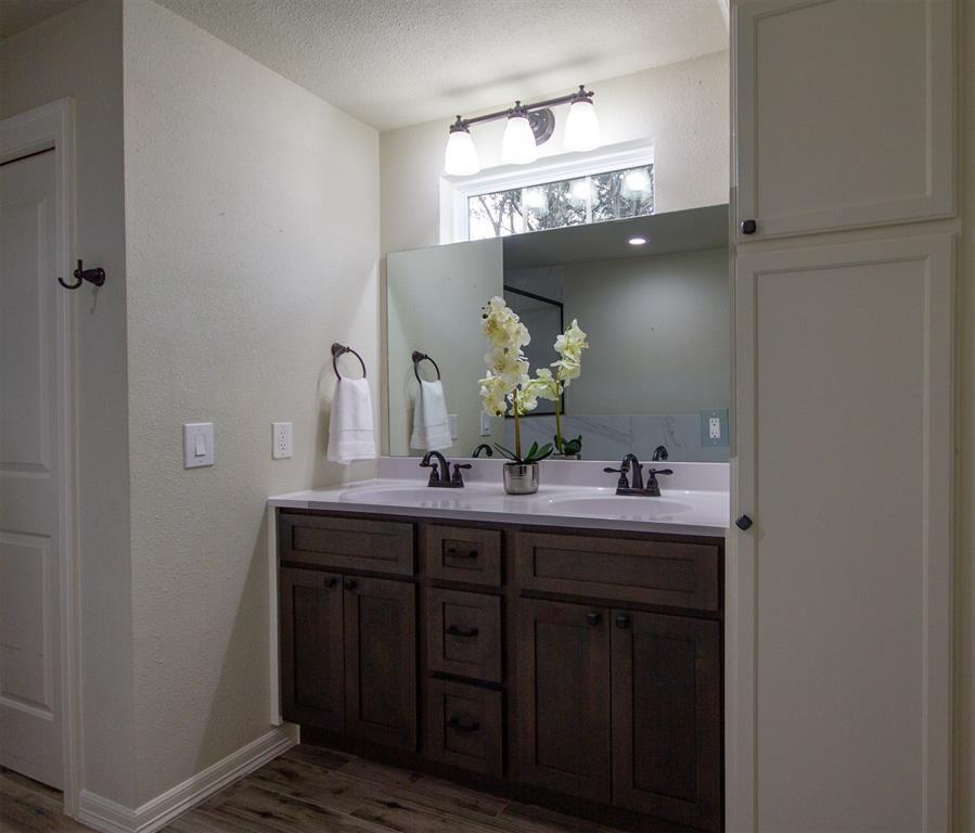 Double sinks and plenty of storage in Master bath