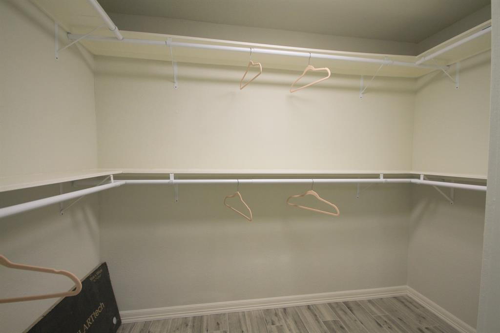 Huge walk in closet attached to master bathroom