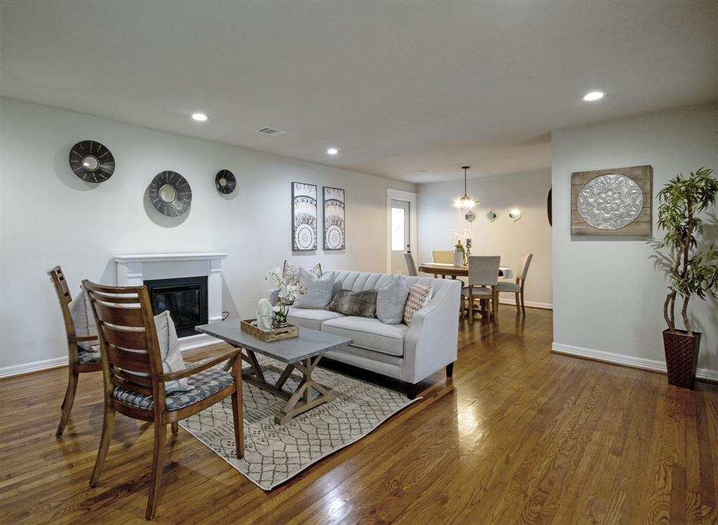 Open concept living and dining room with electric fireplace included