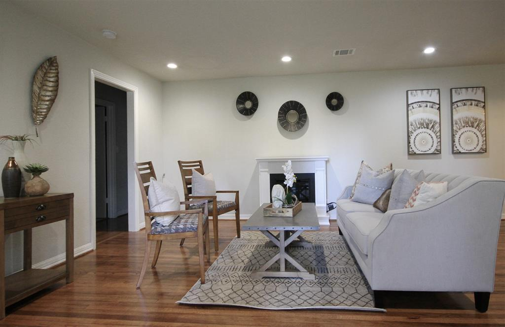 Home features beautiful hardwood flooring throughout