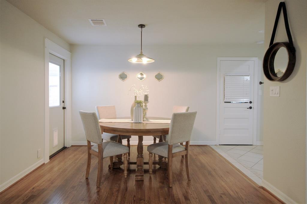 Dining area with easy access to outdoor patio and kitchen. Additional doorway to attached garage.