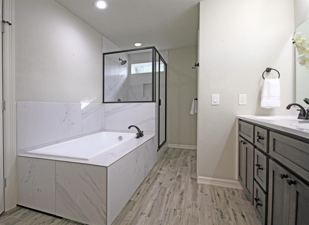 Luxurious Master Bath features large soaking tub, double sinks, standup shower, separate water closet, and huge walk-in closet