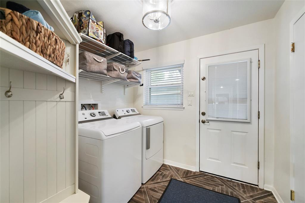 Utility room off of kitchen leading to back yard. Washer and dryer included!