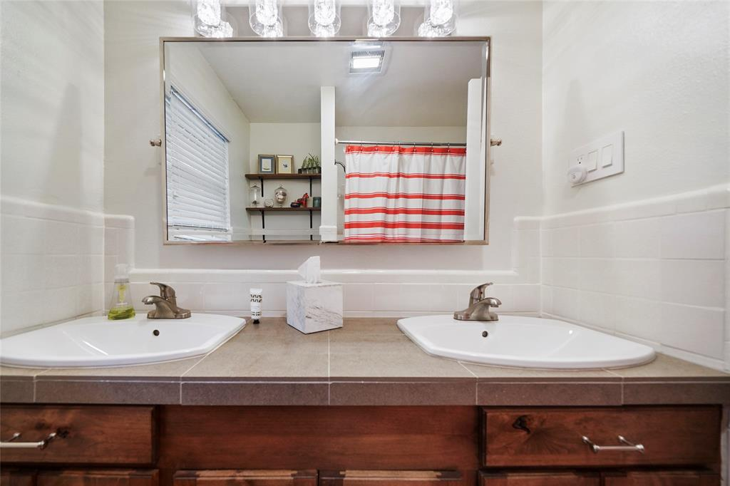 Dual sinks in guest bath with cabinet space.