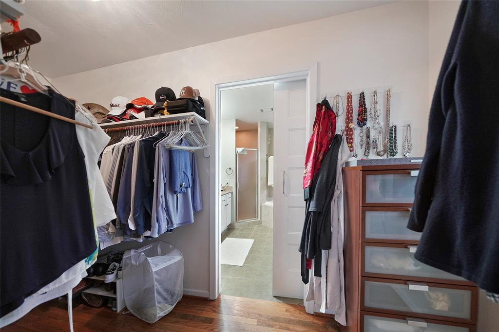 Walk in Master closet leading into master bath. This is a great closet space!