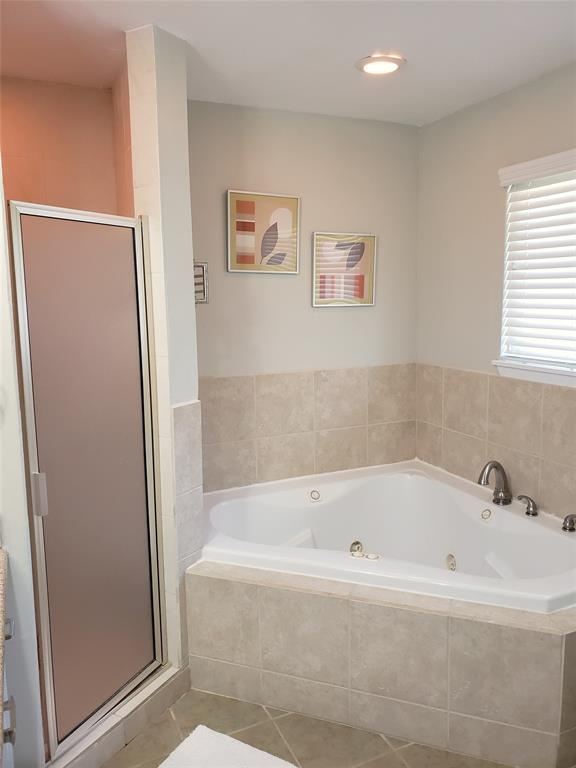 Jacuzzi bath and separate shower in master bath.