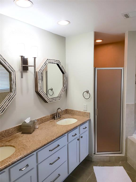 Walk in Shower, jacuzzi bath, dual sinks and plenty of space in this master bath!