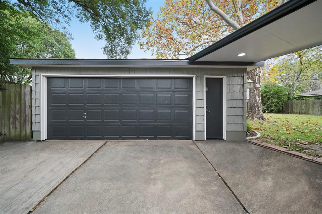 Double garage with driveway space for several cars.