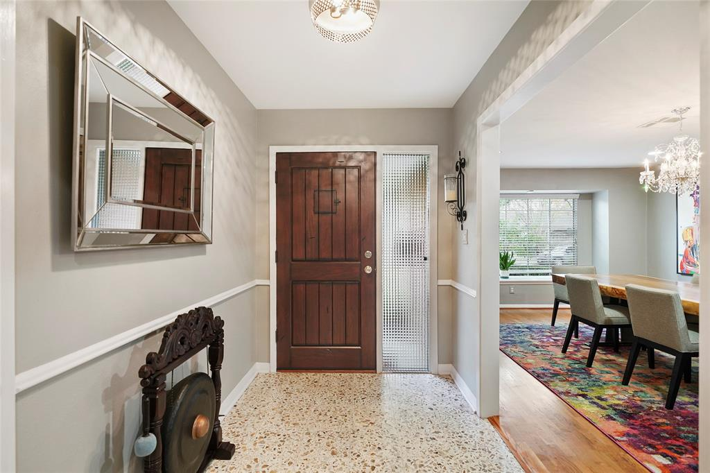 Entrance way leads to open entertaining space.