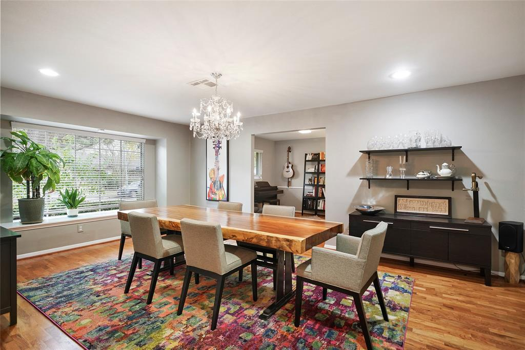 Big and Bright formal living/dining area perfect for entertaining. Stunning Swarovski Chandelier recently added. Light fixture upgrades throughout the home.