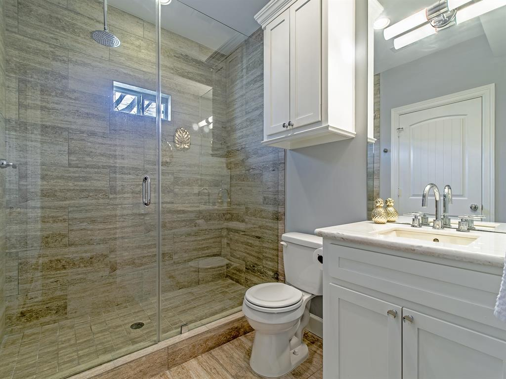 Master bath with spacious frameless glass shower with rainfall feature.