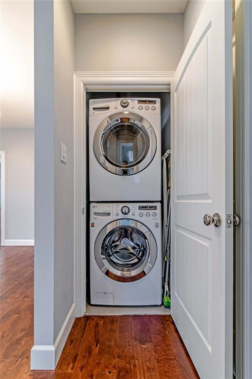 Stackable washer and dryer tucked away in it's own closet space and conveniently located inside home.