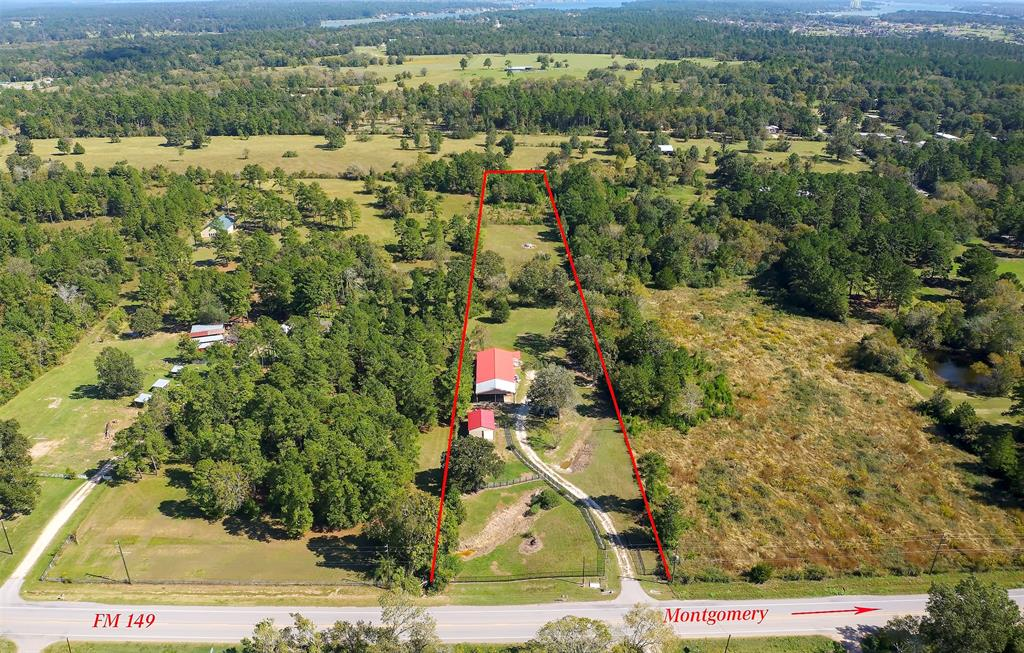 Fantastic 4.49 unrestricted acres near downtown Montgomery and the little league baseball fields. A barn and a metal building with kitchen and bathroom are on the front portion of the property. Build your dream home in the middle or find a great use for this property!