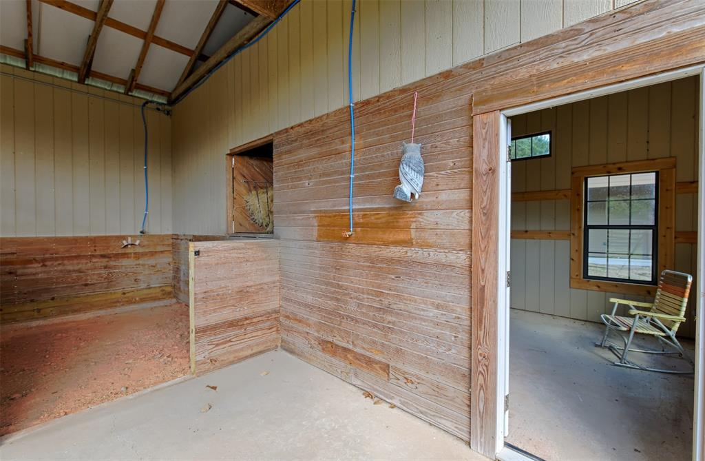 View of the tack room and one of the stalls.
