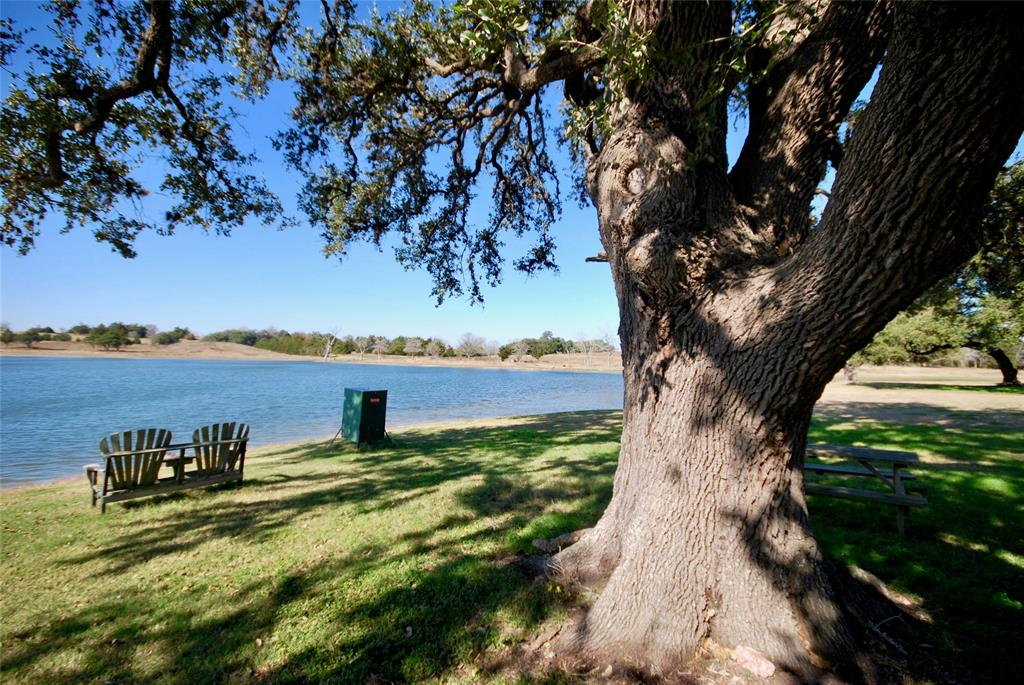 One of a kind Gentlemen's Ranch in Praha, Tx!  112 acres of improved pasture, century oak trees, and your personal 12 acre lake stocked with catfish, bass, & redfish. The rolling terrain gives way to tremendous views, the century oaks provide shade and tranquility to the 2,439 SF farm house. The outdoor living area, kitchen, & pool provide a serene setting to host guests and enjoy the lake views!! 3 water wells are available on the property, as well as 3 other stocked ponds. The 4 bed, 2.5 bath home has been updated with high end finishes. Klekar-Gin Farm is the perfect place to run cattle, farm, raise horses, or just enjoy peaceful rural life! The property has current income production. The pastures ceded 4 cuts of hay in 2019, and the farm has been a popular wedding venue & an attractive weekend rental. The century oak trees, farmhouse, pool, lake, and manicured pastures make this truly an exclusive and once in a lifetime opportunity to own Fayette County's premier Gentlemen's Ranch!