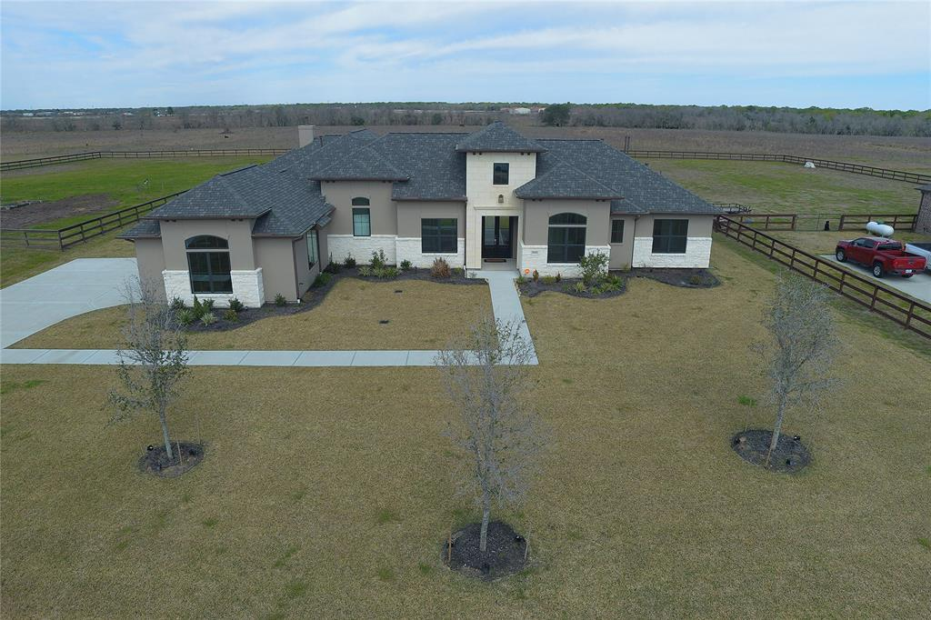 """WELCOME TO SAVANNAH PLANTATION, THE GATEWAY TO YOUR STUNNING """"LIKE NEW"""" HOME & PROPERTY (1.28 acres) ON STRATFORD HALL! CLASSY, ELEGANT, INVITING, WONDERFULLY AND BEAUTIFULLY CUSTOM DESIGNED WITH RANCH STYLE TRANQUILITY, THIS TENTORI CUSTOM BUILT HOME IS BREATHTAKING! CLEAN LINES AND COUNTRY VIEWS ARE JUST THE BEGINNING! OWNERS SPARED NO EXPENSE IN MAKING THIS EXQUISITELY DESIGNED AND CUSTOM BUILT HOME POP WITH ADDTL UPGRADES, I.E.-TEAR DROP LIGHTING, WINE COOLER, BUTLER'S PANTRY, SELF LATCHING DRAWERS, EASY LIFT BLINDS, THE LIST GOES ON! TRUE ATTENTION TO DETAIL! WITH A WALL OF WINDOWS OVERLOOKING THE BACKYARD AND OPEN CONCEPT LAYOUT, ITS THE PERFECT ENTERTAINMENT GATHERING PLACE! THE SPLIT FLOORPLAN ALLOWS FOR PRIVACY WHEN NEEDING TO RETREAT! 4 SPACIOUS BEDROOMS WITH THEIR OWN BATHROOMS (THE MASTER BATH IS HEAVENLY)! OVERSIZED GARAGE AND MUDROOM AREA!  +/-1.28 ACRES READY FOR FAMILY GET TOGETHERS! A SHOWPLACE YOU'LL BE PROUD TO CALL HOME! SCHEDULE YOUR PRIVATE VIEWING TODAY!!"""