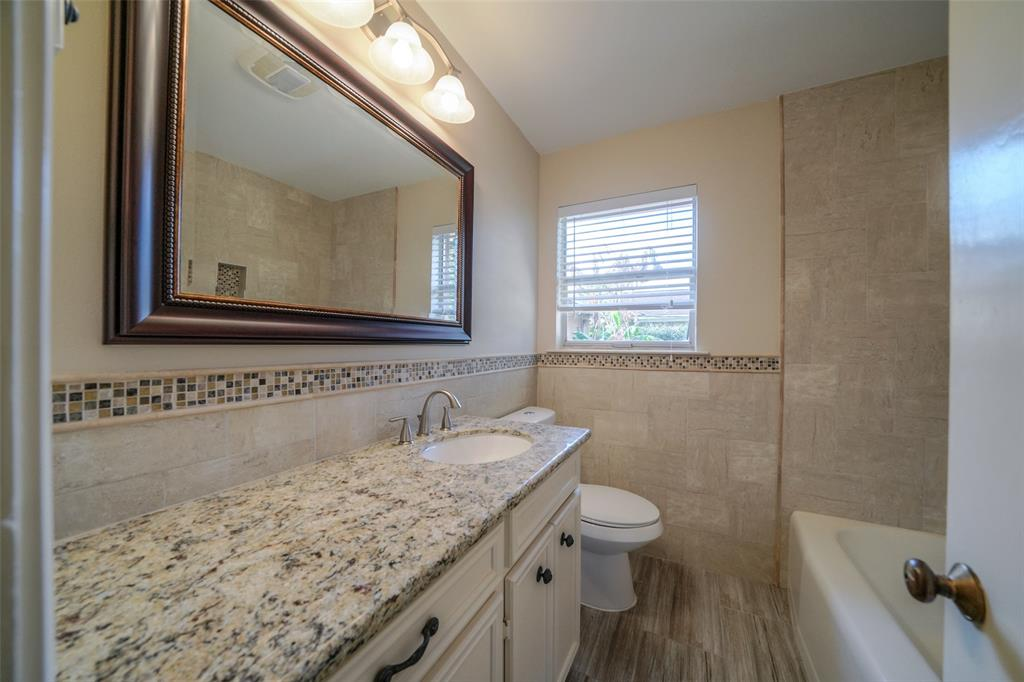 The second bathroom also has granite tops and updated fixtures.